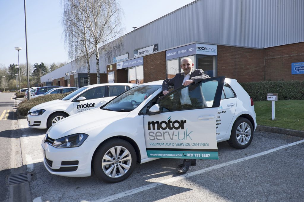 Automotive boss Kam Saleem outside his Motorserv business